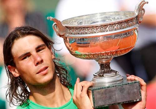 Nadal holds his cup after defeating Roger Federer in their men's final match of the French Open tennis tournament on June 8 at the Roland Garros. (AP)