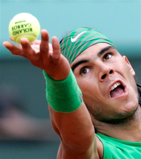 Rafael Nadal serves to Roger Federer during the French Open final. (AP)