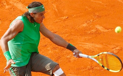 Rafael Nadal returns to Roger Federer during the French Open final. (AP)
