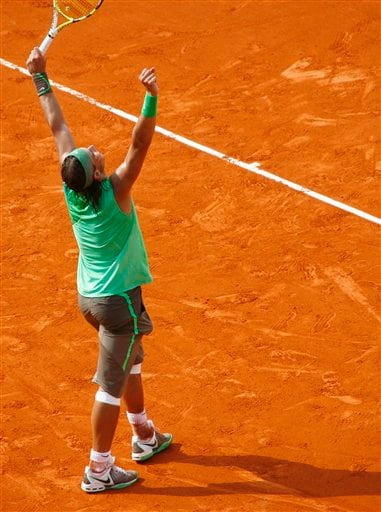 Rafael Nadal exults after championship point in the French Open final. (AP)