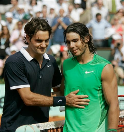Roger Federer congratulates Rafael Nadal after he won the French Open for the fourth time. (AP)