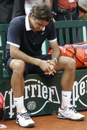 Roger Federer is disappointed after losing another French Open final to Roger Federer. (AP)