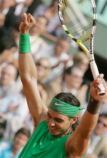 Rafael Nadal celebrates after winning his fourth straight French Open title. (AP)