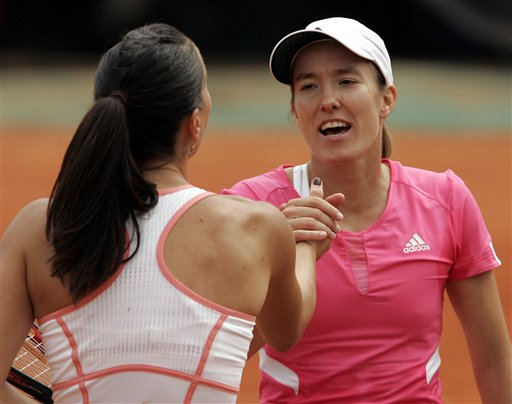 Belgium's Justine Henin shakes hands with Serbia's Jelena Jankovic, after their semifinal match of the French Open tennis tournament, at the Roland Garros stadium, in Paris on Thursday.