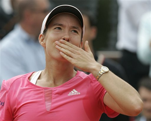 Defending champion Belgium's Justine Henin blows a kiss to the public after defeating Serbia's Jelena Jankovic in their semifinal match of the French Open tennis tournament at the Roland Garros stadium in Paris on Thursday.