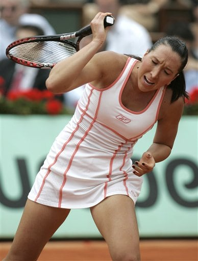 Serbia's Jelena Jankovic reacts as she plays defending champion Belgium's Justine Henin during their semifinal match of the French Open tennis tournament at the Roland Garros stadium in Paris on Thursday.