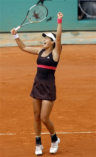 Serbia's Ana Ivanovic celebrates after beating Russia's Maria Sharapova, in a semifinal match of the French Open tennis tournament, at the Roland Garros stadium, in Paris on Thursday.