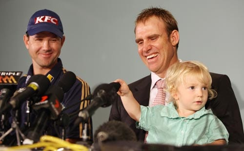 Matthew Hayden with his son Thomas aged 19 months and supported by Australian captain Ricky Ponting announces his retirement from representative cricket at a press conference in Brisbane on January 13, 2009.