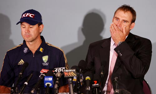 Matthew Hayden supported by Australian captain Ricky Ponting gestures at a press conference in Brisbane on January 13, 2009.