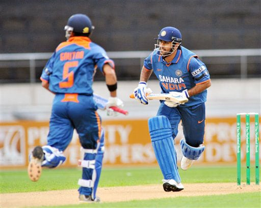 Gautam Gambhir and MS Dhoni run a single against New Zealand in the 2nd One-Day International at Westpac Stadium, Wellington. (AP Photo)