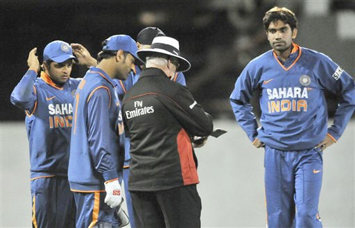 Umpire Rudi Koertzen explains why he is removing Munaf Patel from the bowling after two waist high no balls against New Zealand in the 3rd One-Day International at AMI Stadium in Christchurch. (AP Photo)