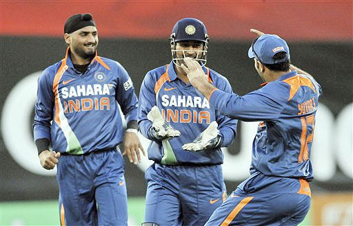 Harbhajan Singh, MS Dhoni and Yuvraj Singh celebrate the dismissal of Ross Taylor for 7 in the 3rd One-Day International at AMI Stadium in Christchurch. (AP Photo)