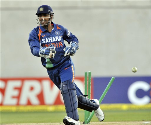 MS Dhoni celebrates the run out of Brendon McCullum by Yuvraj Singh in the 3rd One-Day International at AMI Stadium in Christchurch. (AP Photo)