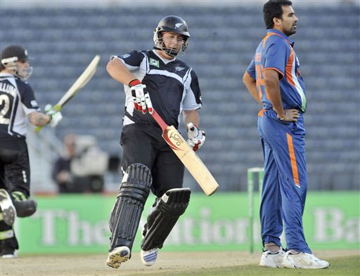 Jesse Ryder runs through as Indian bowler Zaheer Khan looks to the boundary in the 3rd One-Day International at AMI Stadium in Christchurch. (AP Photo)