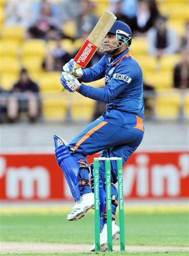 Virender Sehwag hooks the ball to the boundary against New Zealand in the second Twenty20 International at Westpac Stadium in Wellington. (AP Photo)