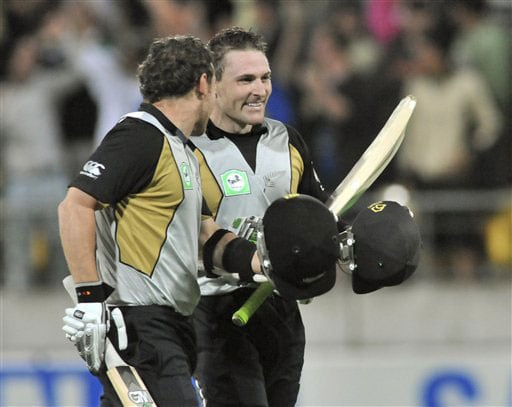 Nathan and Brendon McCullum celebrate their team's win over India in the second Twenty20 International at Westpac Stadium in Wellington. (AP Photo)