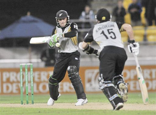 Brendon McCullum hits to the boundary as his brother Nathan begins to run against India in the second Twenty20 International at Westpac Stadium in Wellington. (AP Photo)