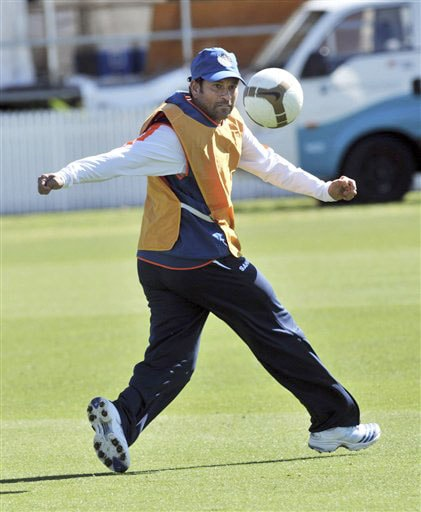 Sachin Tendulkar warms up with a game of football at the Indian team's training for the 1st Test against New Zealand at Hamilton on Wednesday. (AP Photo)