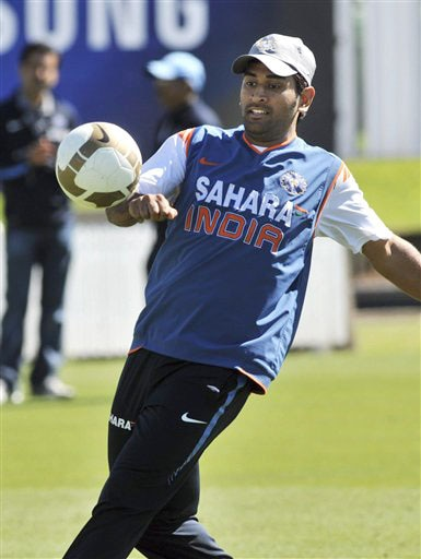 MS Dhoni warms up with a game of football at the Indian teams training for the 1st Test against New Zealand at Hamilton on Wednesday. (AP Photo)