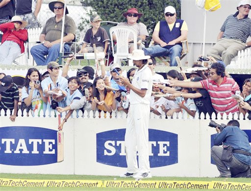 Autograph hunters gather around India's Ishant Sharma on 4th day of the 1st Test in Hamilton on Saturday. (AP Photo)
