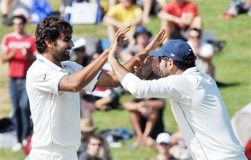 India's Munaf Singh high-fives with Yuvraj Singh after taking the wicket of New Zealand's Ross Taylor for 4 on the 4th day of the 1st Test in Hamilton on Saturday. (AP Photo)