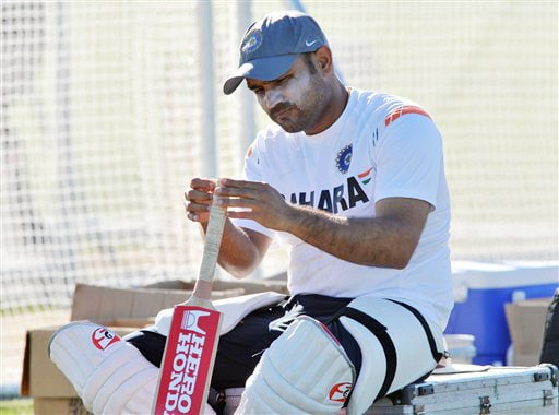 Virender Sehwag inspects his bat in nets after Team India's training at Nelson Park in Napier on Wednesday.(AP Photo)