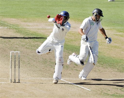 Indian wicketkeeper Dinesh Karthik takes the ball as New Zealand's Ross Taylor makes his ground on the 1st day of the 2nd Test at McLean Park in Napier on Thursday. (AP Photo)