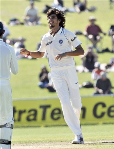 India's Ishant Sharma celebrates the dismissal of New Zealand's Tim McIntosh for 12 on the 1st day of the 2nd Test at McLean Park in Napier on Thursday. (AP Photo)