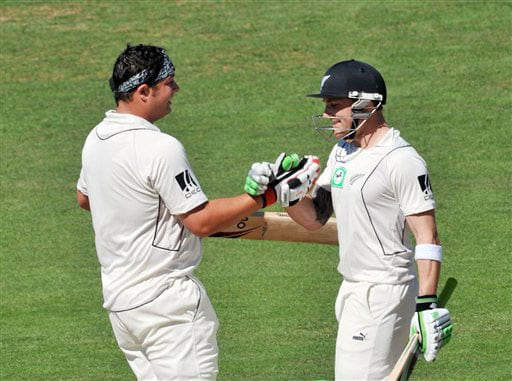 New Zealand's Jesse Ryder is congratulated by Brendon McCullum on his double century against India on the 2nd day of the 2nd Test at McLean Park in Napier on Friday. (AP Photo)