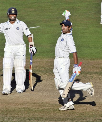 Gautam Gambhir celebrates his century with teammate Sachin Tendulkar against New Zealand during the 4th day of the 2nd Test at McLean Park in Napier on Sunday. (AP Photo)