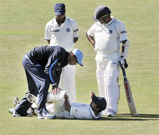 Sachin Tendulkar watches on as Gautam Gambhir receives treatment from the physio during the 4th day of the 2nd Test at McLean Park in Napier against New Zealand on Sunday. (AP Photo)