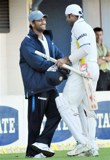 India's injured captain MS Dhoni shakes hands with teammate VVS Laxman (124 not out) in the drawn match against New Zealand on the 5th day of the 2nd Test at McLean Park in Napier on Monday. (AP Photo)