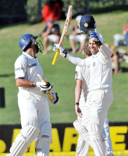 VVS Laxman celebrates his century with teammate Yuvraj Singh against New Zealand on the 5th day of the 2nd Test at McLean Park in Napier on Monday. (AP Photo)