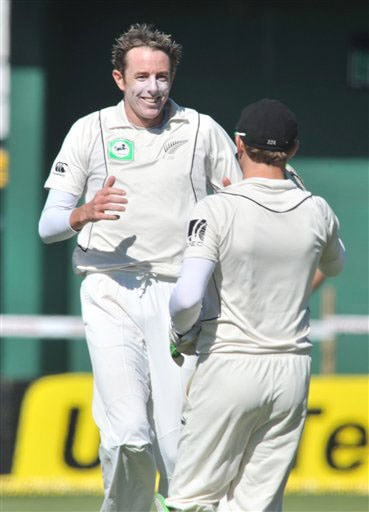 New Zealand's Iain O'Brien celebrates with Brendon McCullum the wicket of India's Virender Sehwag for 48 on the 1st day of the 3rd Test at Basin Reserve in Wellington on Friday. (AP Photo)