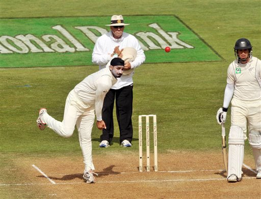 India's Harbhajan Singh bowls pass New Zealand's Ross Taylor on the second day of their 3rd Test at Basin Reserve in Wellington on Saturday. (AP Photo)