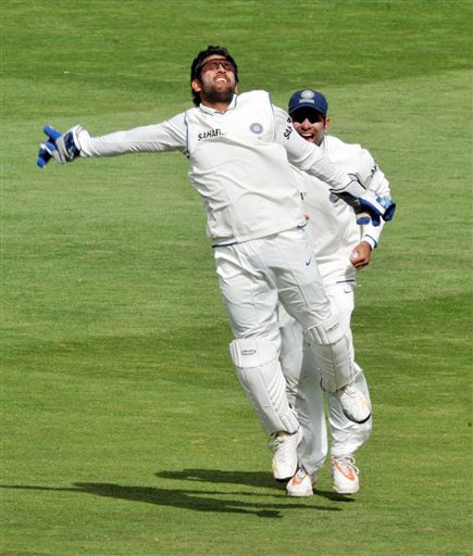 India's MS Dhoni celebrates taking the catch to dismiss New Zealand's Jesse Ryder on the second day of their 3rd Test at Basin Reserve in Wellington on Saturday. (AP Photo)