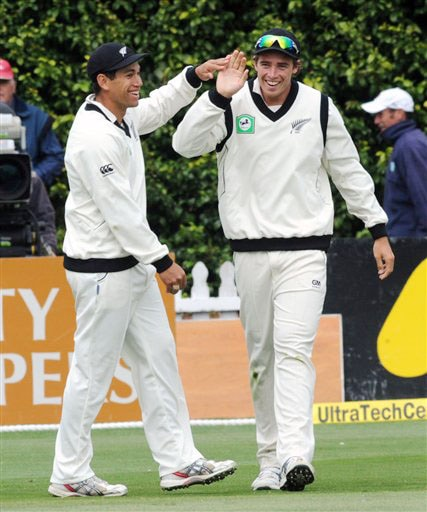 New Zealand's Ross Taylor congratulates Tim Southee for taking Harbhajan Singh's catch on the 4th day of the 3rd Test at Basin Reserve in Wellington on Monday. (AP Photo)