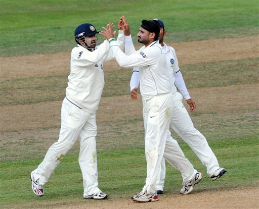 India's Harbhajan Singh celebrates with Gautam Gambhir after trapping New Zealand's Martin Guptill lbw for 49 on the 4th day of the 3rd Test at Basin Reserve in Wellington on Monday. (AP Photo)