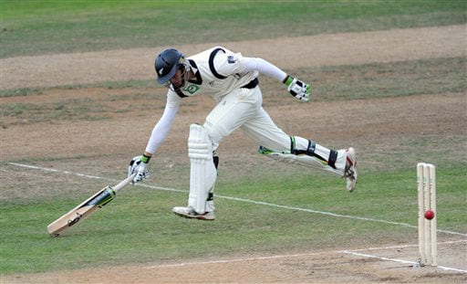 New Zealand's Martin Guptill makes his ground against India on the 4th day of the 3rd Test at Basin Reserve in Wellington on Monday. (AP Photo)