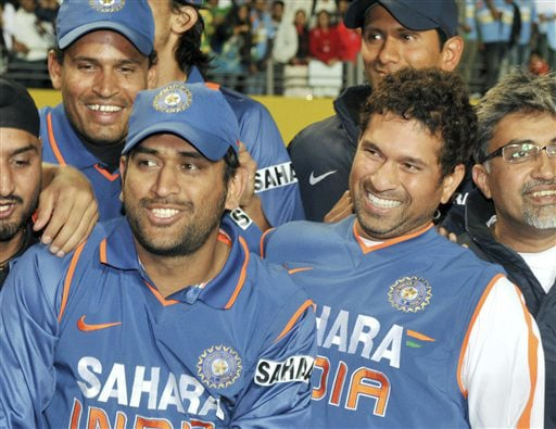 India captain MS Dhoni and Sachin Tendulkar celebrate their team's 3-1 ODI series win over New Zealand at Auckland on Saturday. (AP Photo)