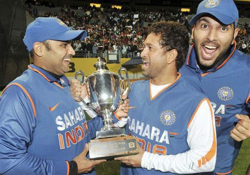Virender Sehwag, Sachin Tendulkar and Yuvraj Singh celebrate their team's 3-1 series win over New Zealand in the ODI match at Auckland on Saturday. (AP Photo)