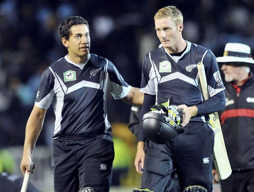 Ross Taylor and Martin Guptill celebrate their team's win over India in the 5th ODI match at Auckland on Saturday. (AP Photo)