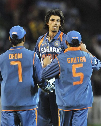 Ishant Sharma is congratulated after taking the wicket of Jesse Ryder in the 5th ODI match at Auckland on Saturday. (AP Photo)