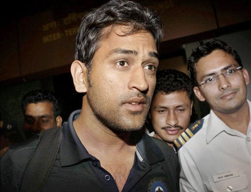 India captain Mahendra Singh Dhoni arrives at the airport in New Delhi on Thursday after winning the Test series in New Zealand. (AP Photo)