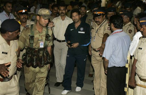 India's Sachin Tendulkar arrives at Chatrapati Shivaji International Airport in Mumbai on Wednesday. The Indian team returned after an historic Test series win in New Zealand. (AP Photo)