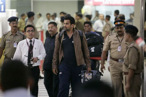 India's Zaheer Khan arrives at the Chhatrapati Shivaji International Airport in Mumbai on Wednesday. The Indian team returned after the Test series win in New Zealand. (AP Photo)