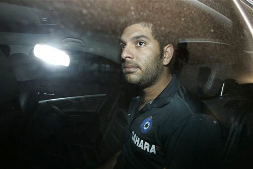India's Yuvraj Singh is seen after arriving at the Chhatrapati Shivaji International Airport in Mumbai on Wednesday. The Indian team returned after the Test series win in New Zealand. (AP Photo)