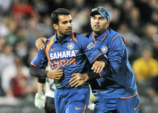 Zaheer Khan celebrates within Yuvraj Singh the wicket of Ross Taylor in the first Twenty20 International at Christchurch on Wednesday. (AP Photo)