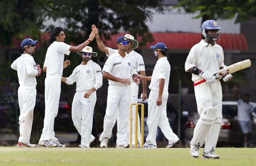 Indian cricketers congratulate their bowler Ishant Sharman for taking the wicket of Mahela Udawatta on the final day of a three day practice match between Sri Lanka A team and India in Colombo, Sri Lanka on July 20, 2008.
