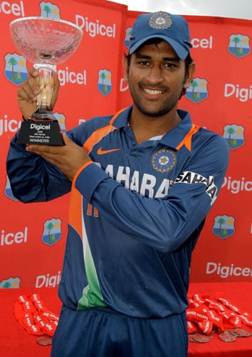 Mahendra Singh Dhoni poses with the trophy after his team won the One-Day International series against the West Indies at Beausejour Cricket Ground in St. Lucia. (AP Photo)